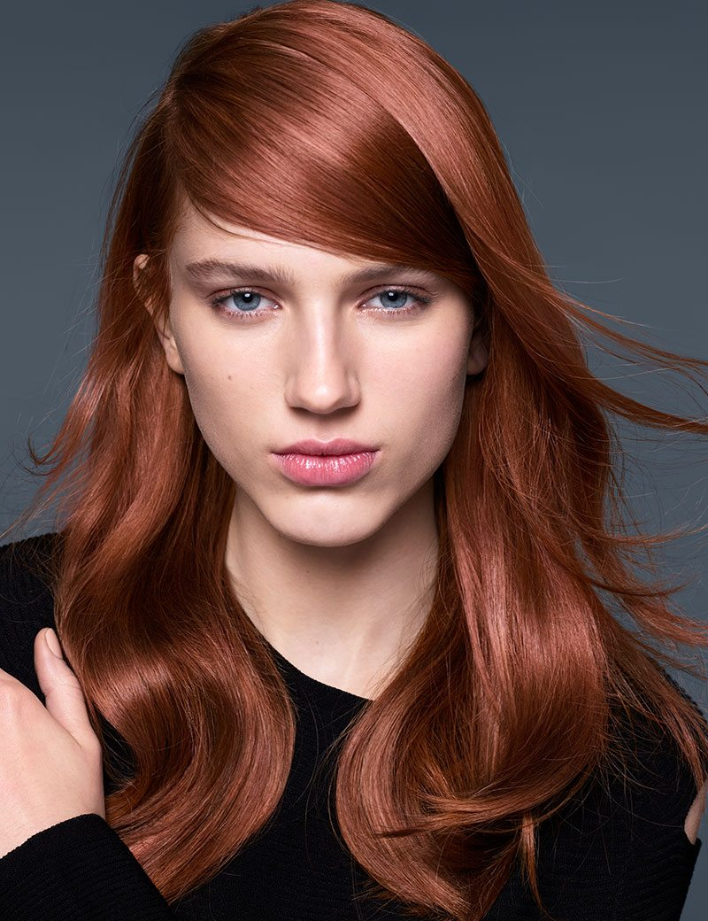 Get shiny, glossy hair with pop of copper haircolor